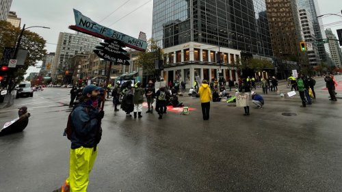4 arrested during Extinction Rebellion 'die-in' at downtown Vancouver intersection