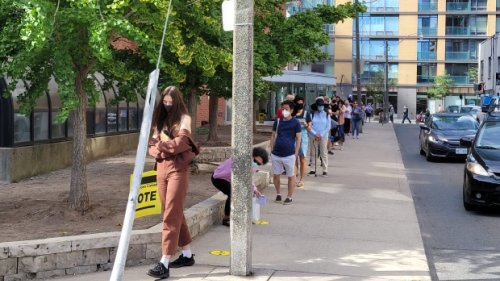 Long lineups form outside some polling stations across Toronto