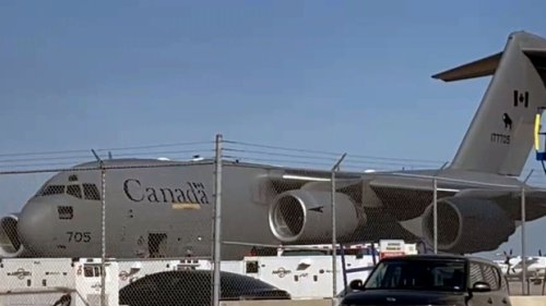 First flight of Afghan refugees who helped CAF arrives in Canada