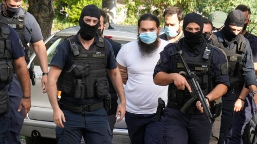 Greek priest charged over acid attack on 7 senior bishops
