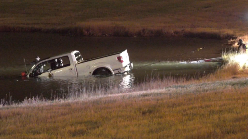 Pickup truck pulled from retention pond along Stoney Trail, no sign of driver