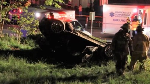 Burnaby traffic: More than a dozen first responders called to help driver who flipped vehicle, crashed into tree
