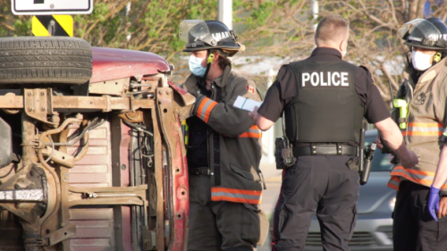 While heading back to station from another call, firefighters help driver after rollover