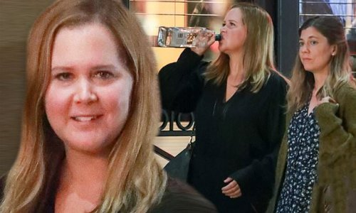 Amy Schumer swigs a bottle of alcohol while filming new Hulu series