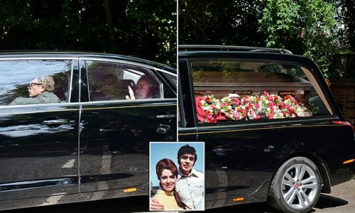 Engelbert Humerpdinck waves to fans as he bids farewell to his wife