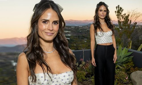 Jordana Brewster flashes her toned midriff in a white crop top