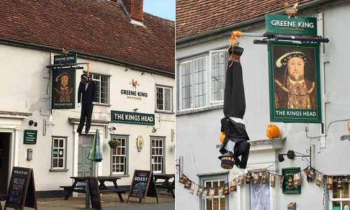 Race row as 'blackface' figure is HANGED from pub sign