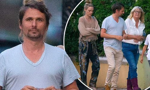 Matt Bellamy heads out for a stroll with wife Elle Evans and his son