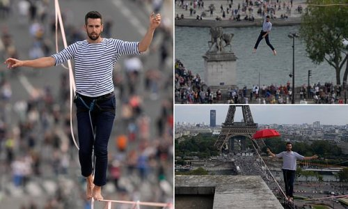 Daredevil walks on tightrope 200ft above the ground from Eiffel Tower