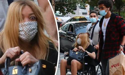 Wendy Williams is pushed in a wheelchair in NYC