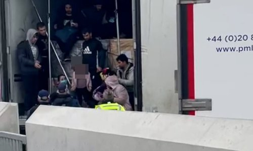 Police find group of migrants huddled in back of a lorry