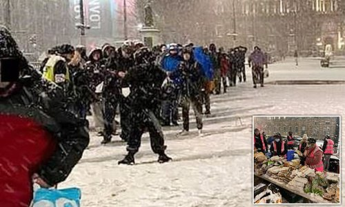 Outrage as hundreds forced to queue in the snow for hot food