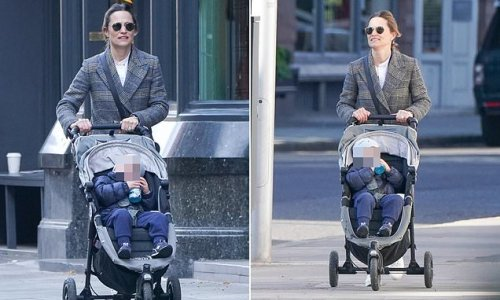 Pippa Middleton wraps up for a walk through west London with son