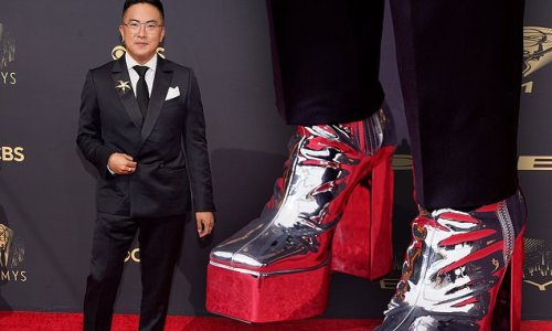 Bowen Yang stands tall in silver platform HEELS at Emmy Awards in LA
