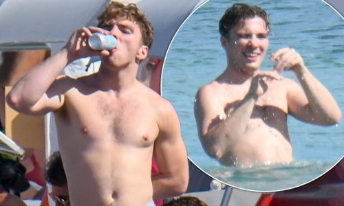 Rocco Richie downs drinks and frolics in the sea in Sardinia