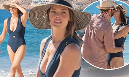 Ashley Greene is stunning in a plunging swimsuit with husband
