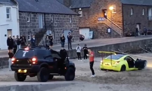 Supercar towed from beach after 'muppet show-off' driver gets stuck