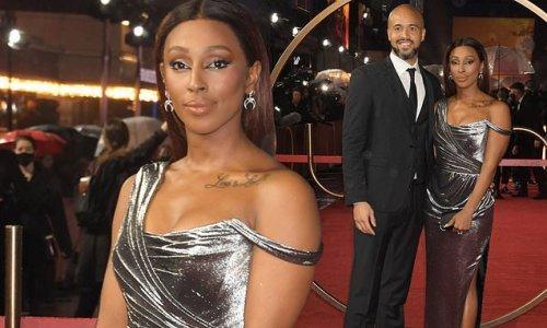Alexandra oozes glamour in a silver gown alongside Darren Randolph