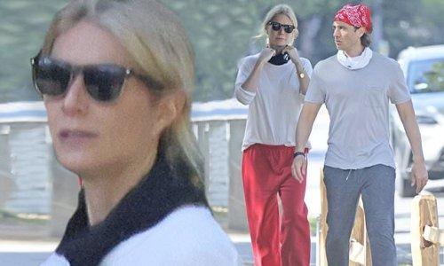 Gwyneth Paltrow wears red sweatpants on a walk with Brad Falchuk
