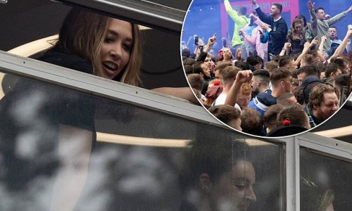 Myleene Klass leans out of window to get closer look at football fans