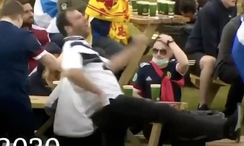 Angry Scotland fan tries to kick table and misses after Euro 2020 exit
