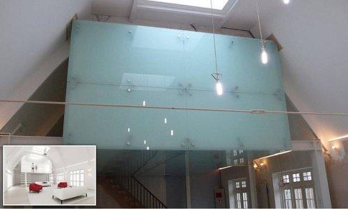 Architect suspended after designing £450k 'wonky' home cinema