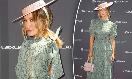 Delta Goodrem wears a BANNED dress to an official Melbourne Cup event