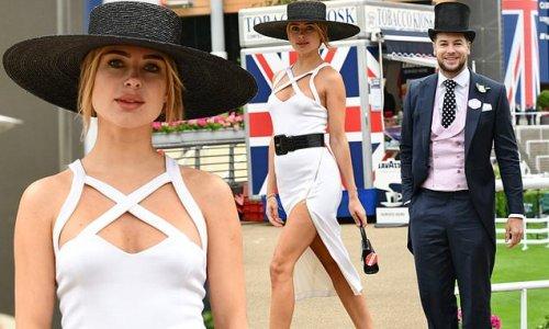 Kimberley Garner puts on a leggy display in white thigh-split dress