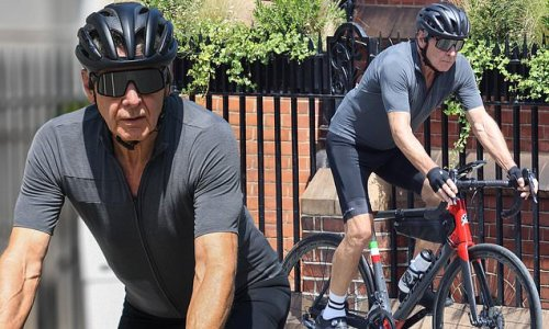 Harrison Ford shows off his toned physique as he cycles through London