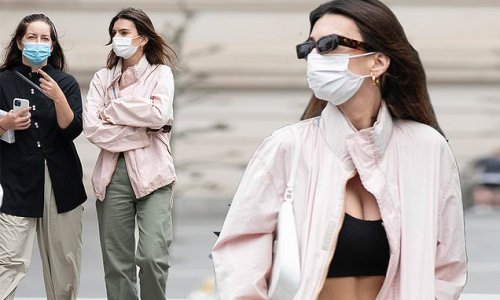 Emily Ratajkowski bares her midriff in a bra top outside The Met
