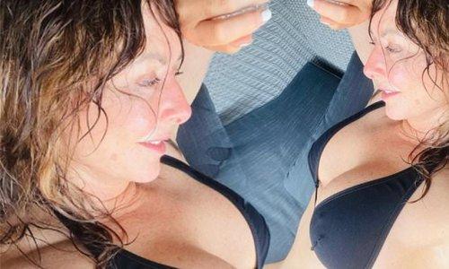 Carol Vorderman showcases her incredible figure in a black bikini