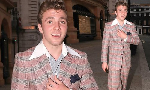 Rocco Ritchie sports rockabilly hairdo and 1950s-style checked suit