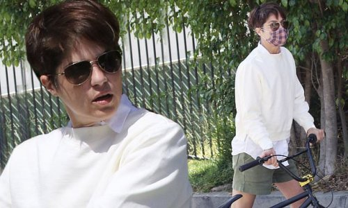 Selma Blair looks sporty as she tries out a bike at estate sale in LA