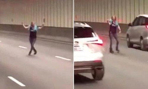 Disturbing moment a woman is spotted dodging cars in a busy tunnel