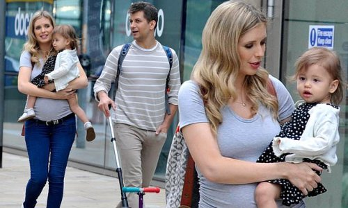 Rachel Riley cradles daughter Maven with husband Pasha Kovalev