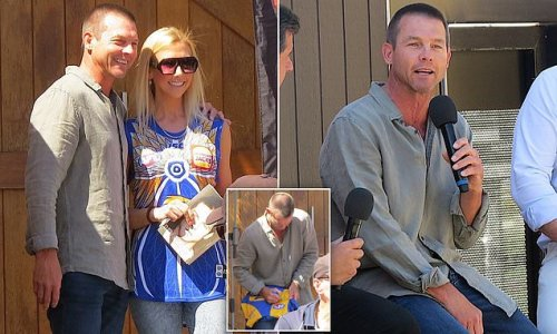 Ben Cousins poses for photos with fans in ahead of AFL Grand Final