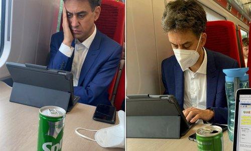 Ed Miliband is slammed by rail passenger for not wearing face mask