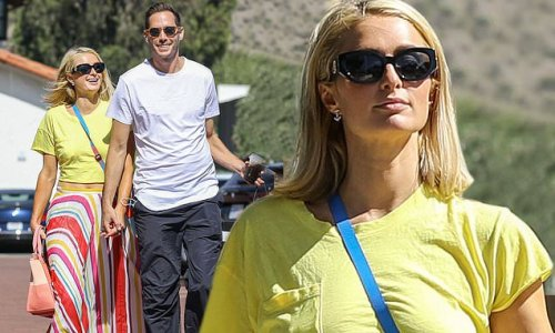 Paris Hilton holds hands with fiancé Carter Reum while shopping