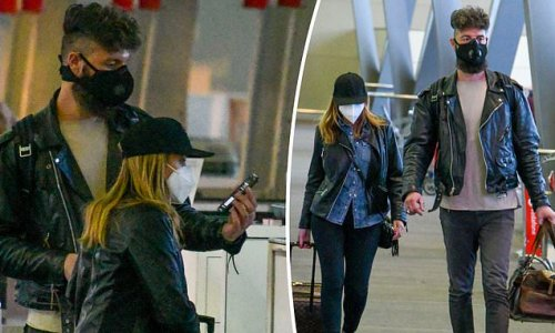 Dannii Minogue and her boyfriend Adrian Newman fly back to Melbourne