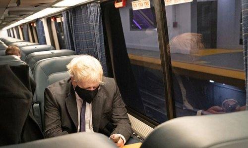 Boris Johnson hops on Amtrak for White House meeting with Biden
