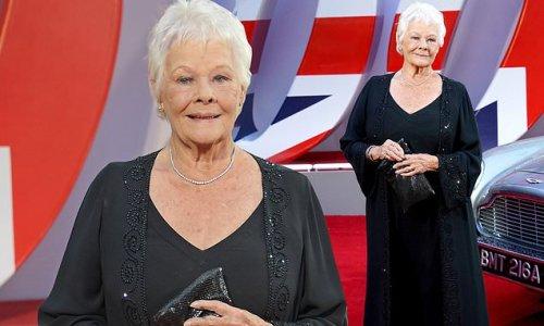 Judi Dench looks elegant in a black longline cardigan at Bond premiere