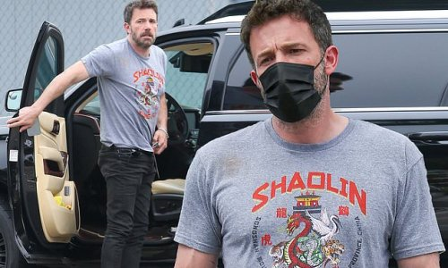 Ben Affleck models his muscled physique in a Kung Fu t-shirt