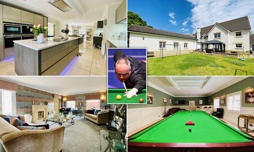 Snooker ace John Higgins hopes to pocket £825,000 for his mansion