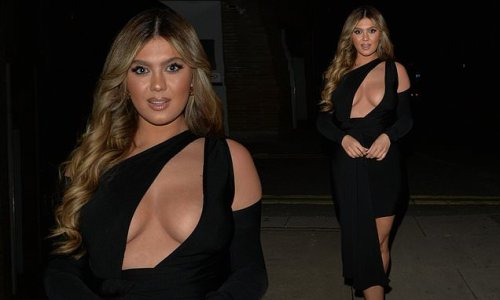 Belle Hassan puts on a VERY busty display in cut-out dress