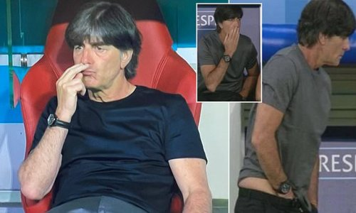 Fans catch Germany boss Joachim Low sniffing his fingers again!