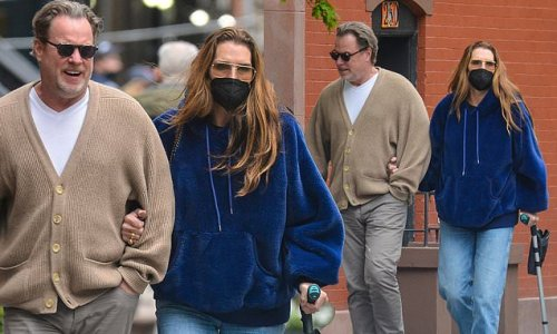 Brooke Shields leans on husband of 20 years Chris Henchy, uses cane