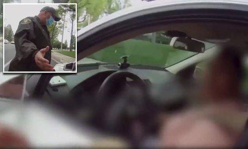 Racist black teacher berates Latino cop and calls him a 'murderer'