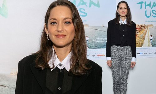 Marion Cotillard looks chic in a sheer blouse and floral trousers