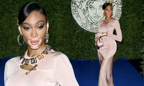 Winnie Harlow showcases her impeccable in figure-hugging nude dress