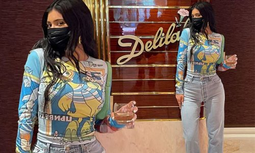 Kylie Jenner models a skintight shirt to drink Kendall's tequila